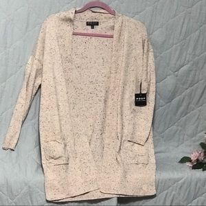 Poof light pink and black speck cardigan.